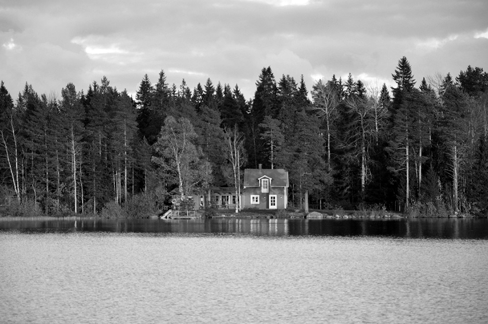 House across Nydala Lake